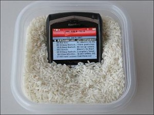 Phone in Rice - Flickr.com / husin.sani